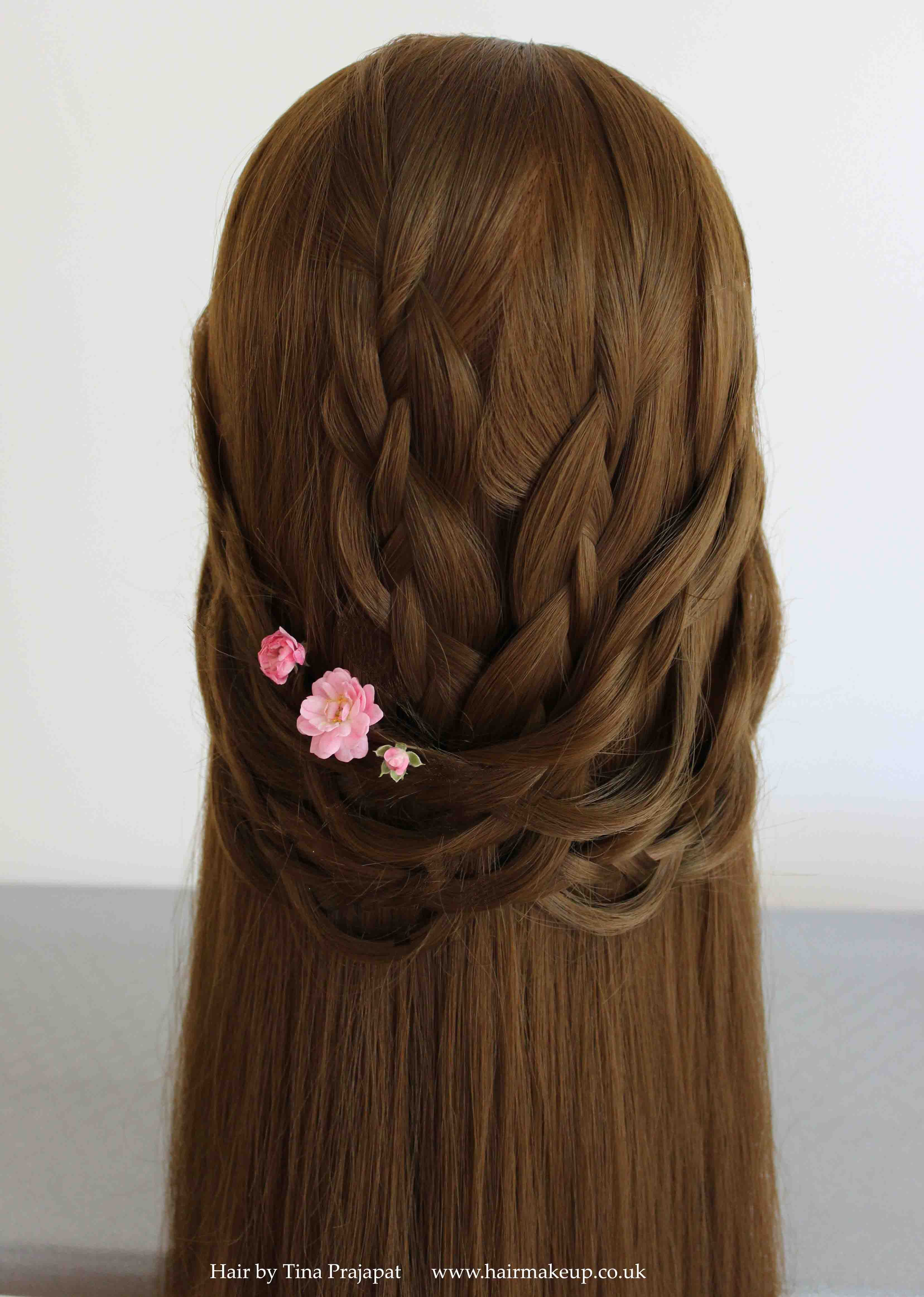 These loosely draped braids create a soft half up bridal hairstyle.