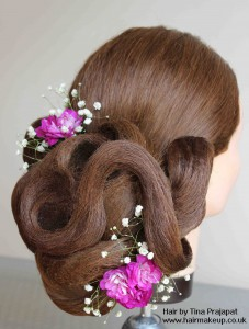 sculpted hair with pink flowers